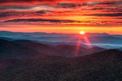 north-carolina-blue-ridge-mountain-autumn-sunrise-burning-sun-crests-mountains-lights-up-sky-above-as-seen-434218861